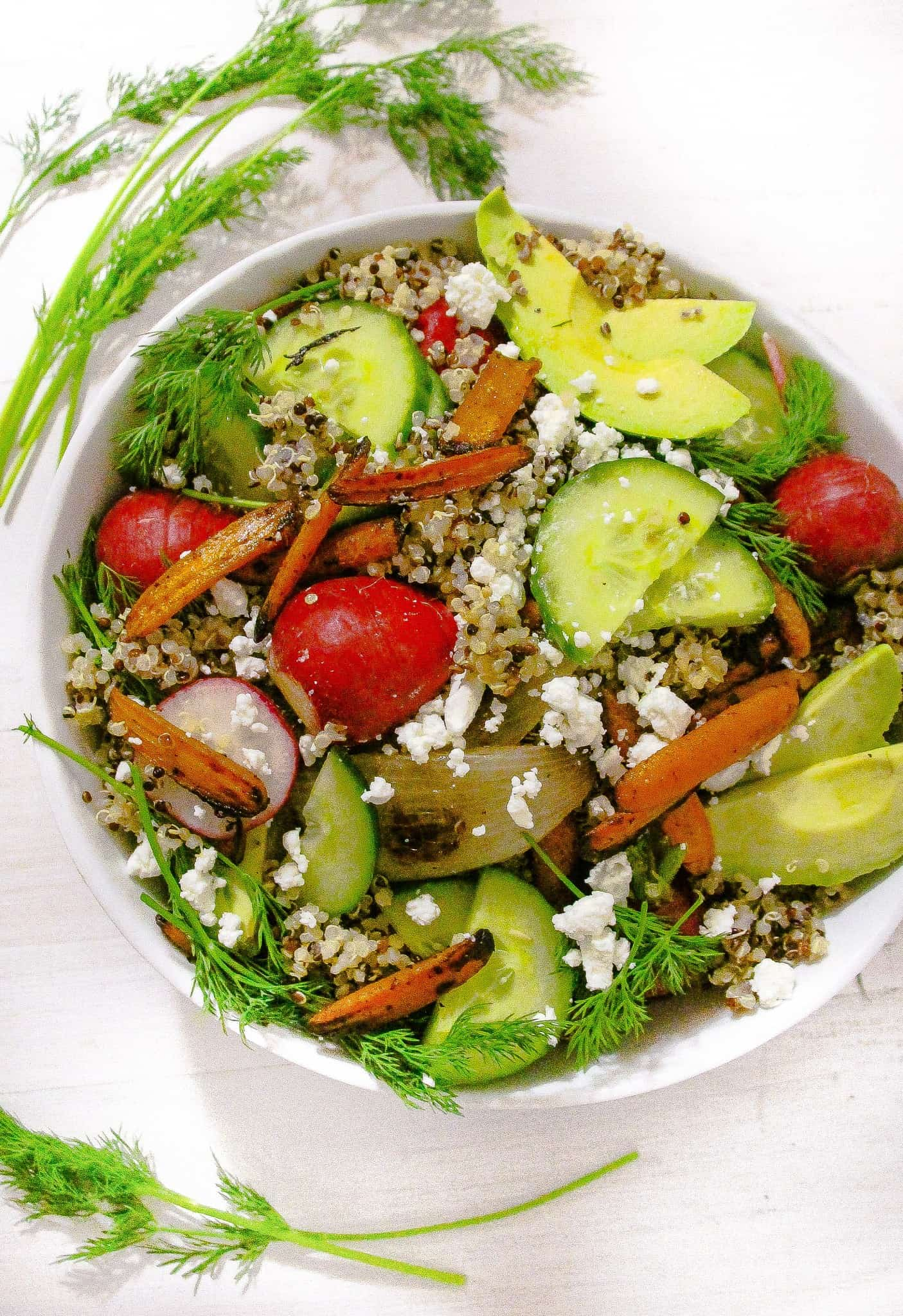 An easy mixed vegetable quinoa salad with quinoa, avocados, carrots ...