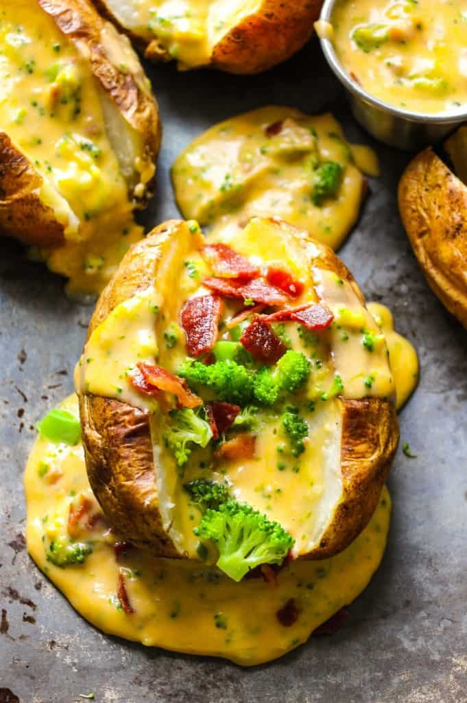 Baked Potatoes Loaded With Broccoli Bacon Cheese Sauce